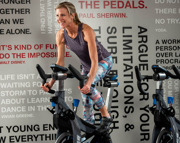 Our Director of Personal Training, Meg Sharp, riding on a Stages bike in our RIDE Studio