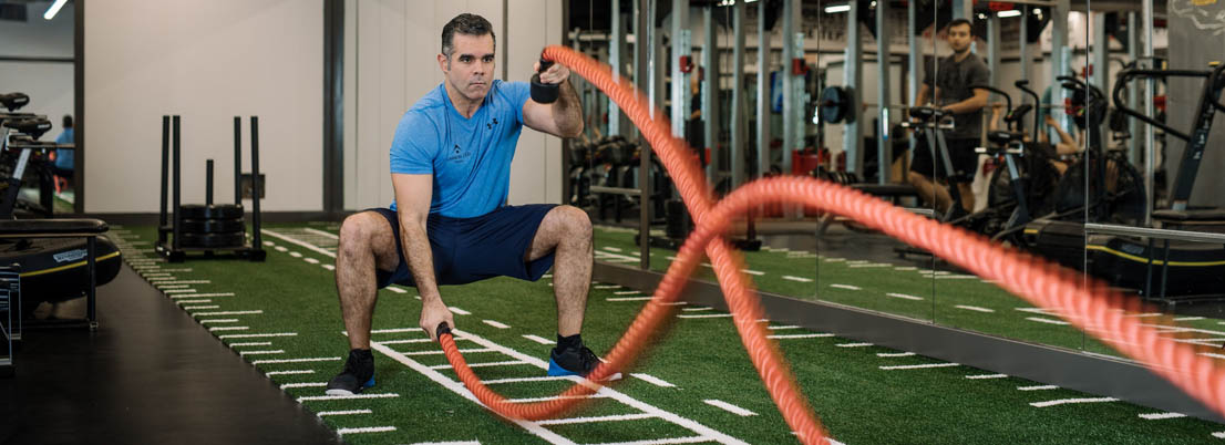 Member doing battle ropes in the Strength Gym