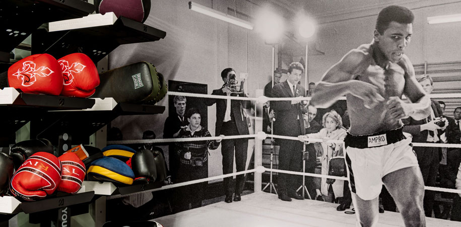Boxing space at the Club with equipment and Ali mural