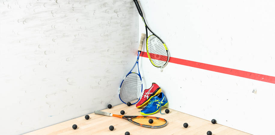 Squash racquets and shoes on a squash court